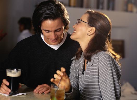 Couple talking at bar.