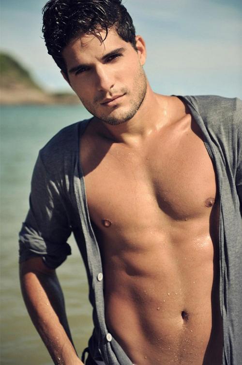 Hot guy on beach.